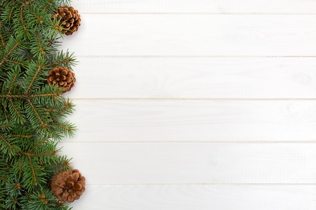 Christmas wooden  with fir tree frame and cone copyspace.