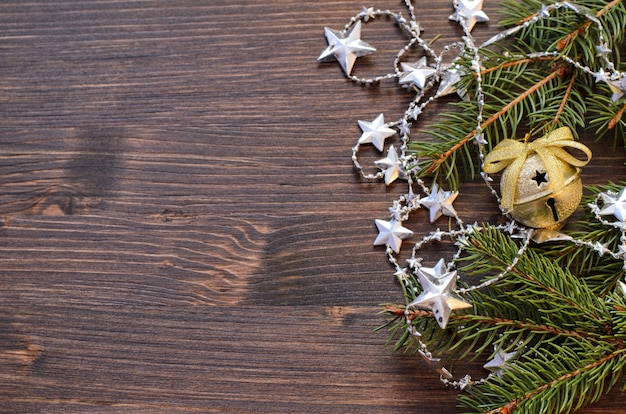 Christmas wooden with fir tree and shiny decorations