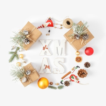 Christmas  word xmas wreath christmas decoration white  top view new year flat lay