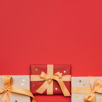 Christmas wrapped gift with stars on red background