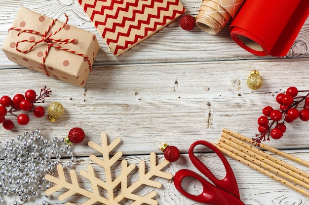 Christmas wrapping and decorating items on wooden  with copyspace
