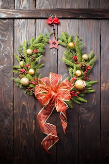 Christmas wreath on dark wooden door