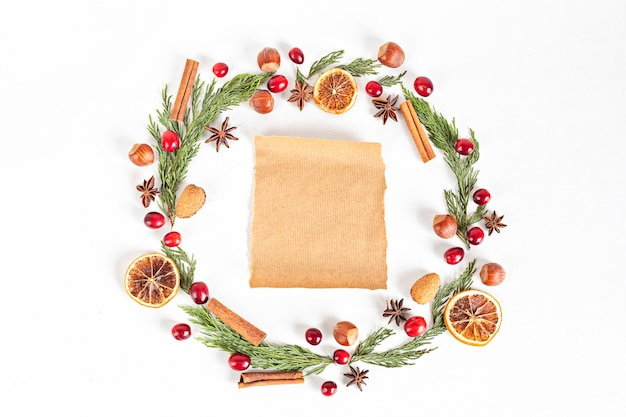 Christmas wreath frame with nuts and cranberries, flat lay, top view.