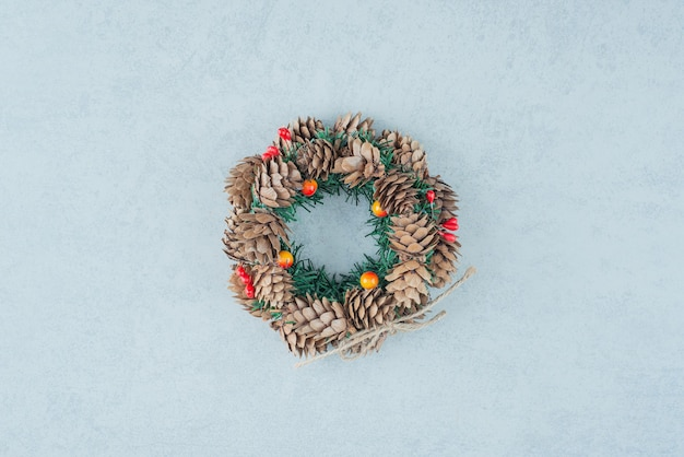 A christmas wreath from pinecone on marble background. high quality photo