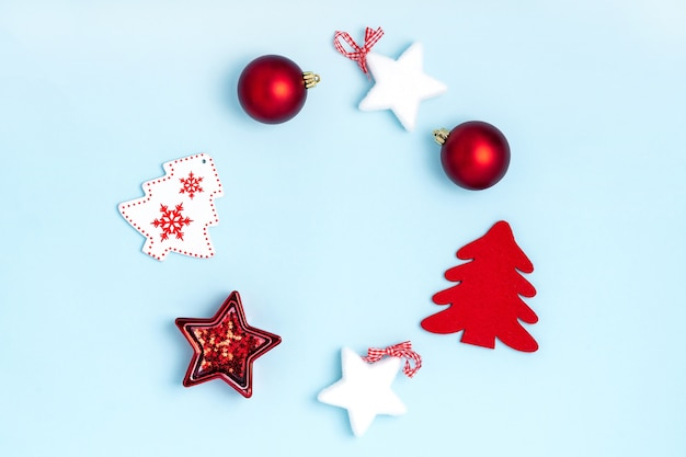 Christmas wreath from red balls, white stars and chrismas trees