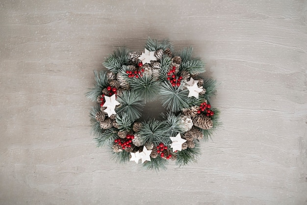Christmas wreath on gray background. winter holiday pattern. copy space. new year.