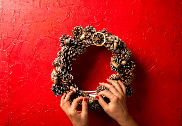 Christmas wreath held by hand