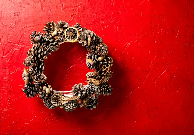 Christmas wreath on red background