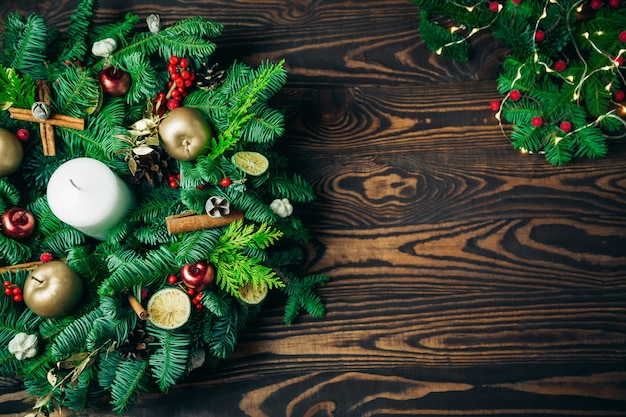 Christmas wreath on a rustic wooden background with copy-space for letter