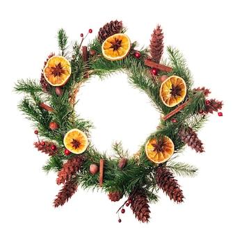 Christmas wreath with dry orange slices and cinnamon sticks