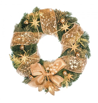 Christmas wreath with golden decorations on white