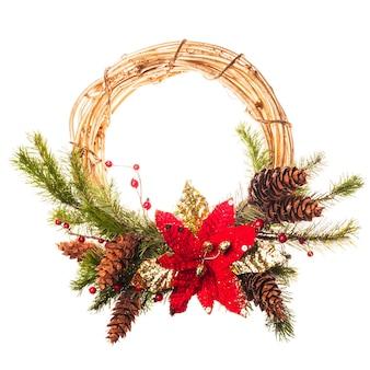 ポインセチアとモミの枝とクリスマスリース