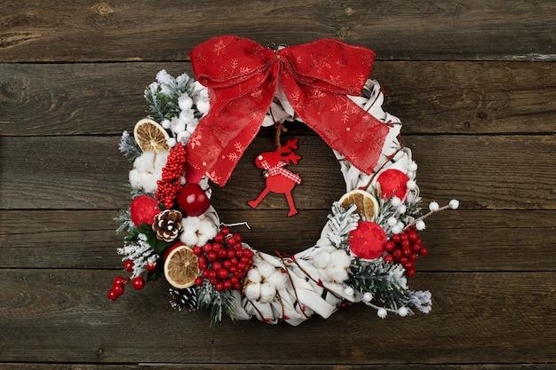 Christmas wreath on wood tablr