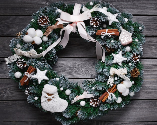 Christmas wreath on the wooden background.