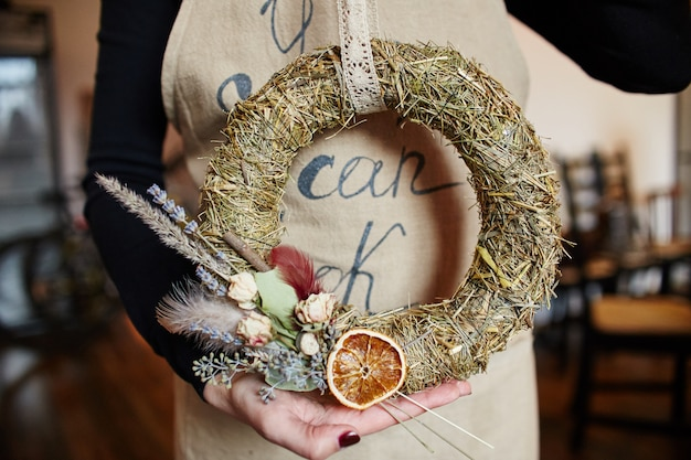 Christmas wreaths made of straw and various herbs