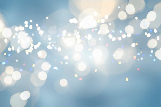 Рождественские желтые огни боке расфокусированные синий фон