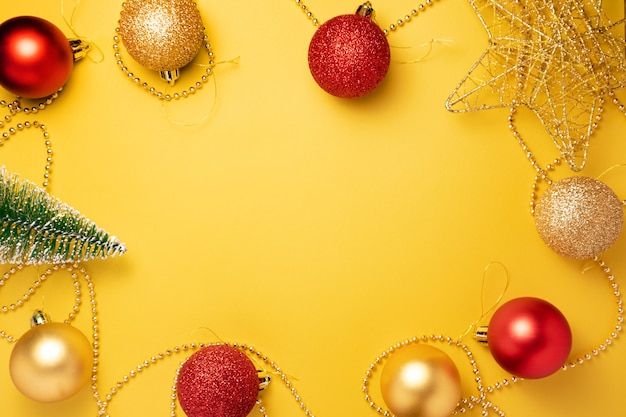 Christmas yellow and red decorations a on illuminating colored background