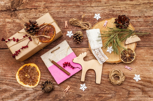Christmas zero waste .  eco friendly packaging. festive boxes in craft paper and sacks with different organic decorations. old wooden