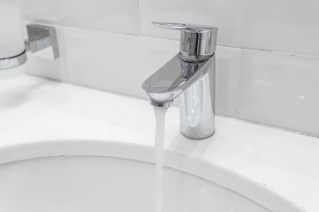 Chrome faucet in modern bathroom
