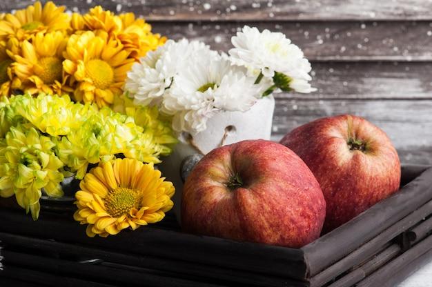 Chrysanthemum in tin pot and apples