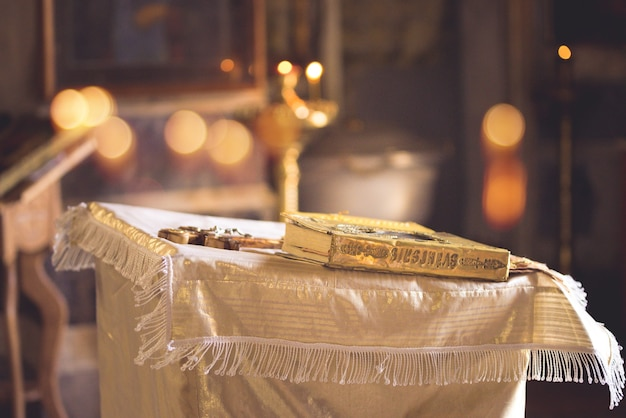 Church attribute a golden bible with lock on the altar.