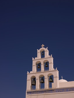 Church bell tower in santorini greece