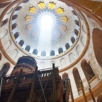 The church of the holy sepulchre with majestic light falling through the slylight window, jerusalem , israel
