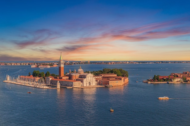 Church of san giorgio maggiore surrounded by canals during the sunset in venice, italy