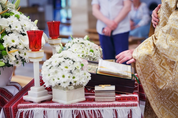 Church supplies for baptism on the table. ceremony of a christening in church.