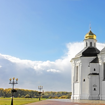 Church with golden domes in an autumn park