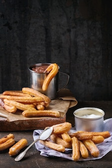 Churros with chocolate and sugar
