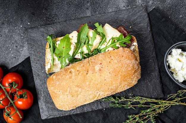 Ciabatta sandwich with fresh goat cheese, pear marmalade and arugula.