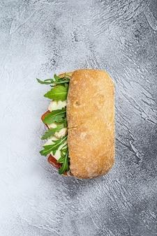 Ciabatta sandwich with fresh goat cheese, pear marmalade, and arugula