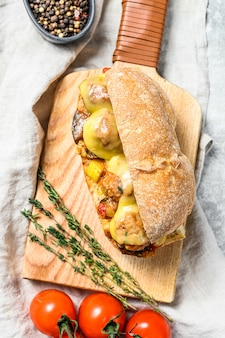 Ciabatta sandwich with meatballs, cheese and tomato sauce. top view