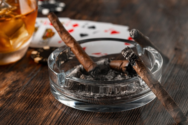 Cigar and playing cards on casino table