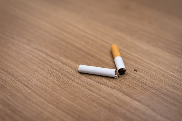 Cigarette breaking on the table for quit smoking concept.