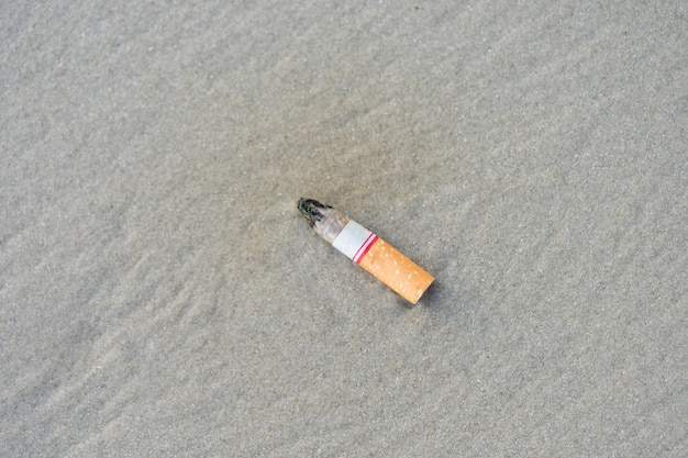 The cigarette butts have been successfully smoked. left beach is polluting