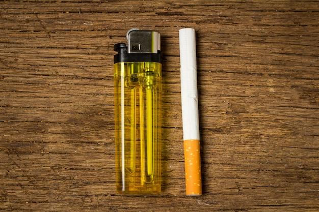 Cigarette lighter on old wood