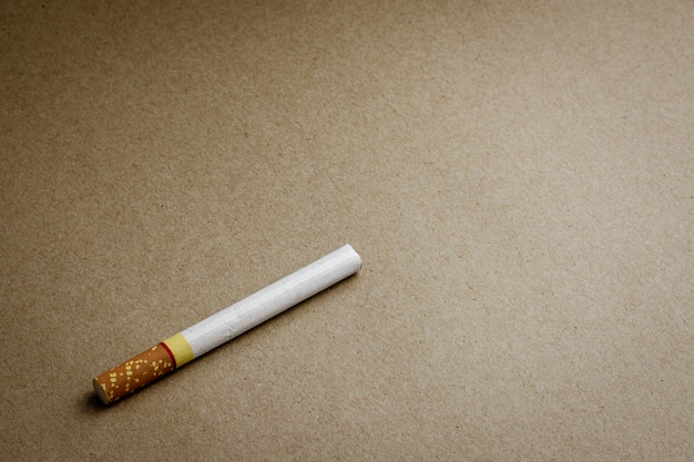 A cigarette on recycled craft paper