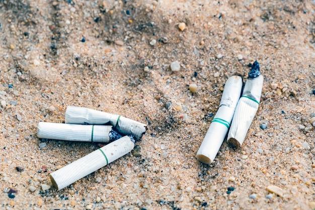 Cigarette stub in the trash