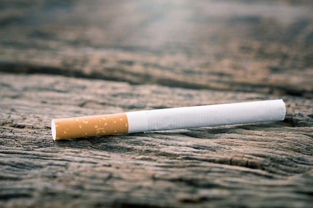 Cigarette on a wooden table.ligth and color effect.