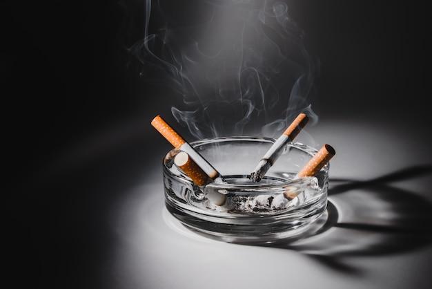 Cigarettes in ashtray spotlight