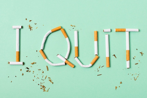 Cigarettes assortment on green background
