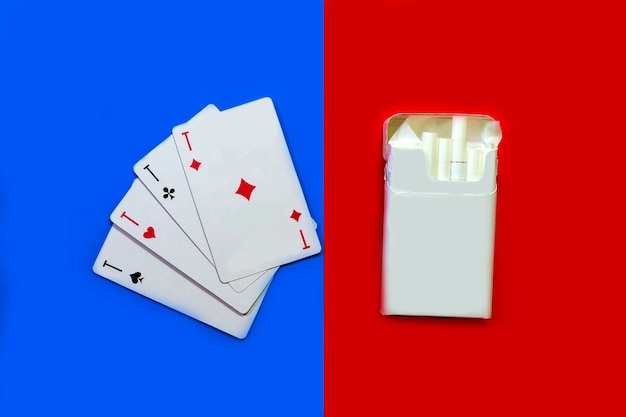 Cigarettes and cards cigarettes on a red background and cards on a blue background