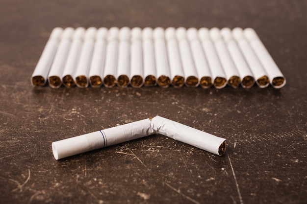 Cigarettes on a dark marble background. bad habit. care for health. leave off smoking