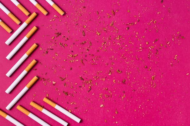 Cigarettes frame on pink background