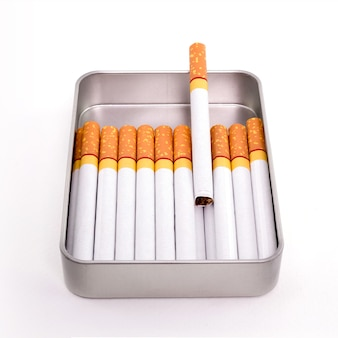 Cigarettes in metal box isolated on white background