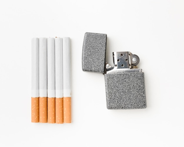 Cigarettes with lighter beside