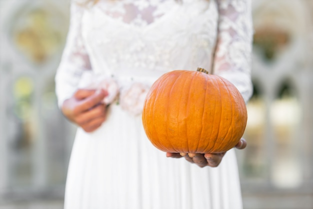 Cinderella princess holding pumpkin in her hands. fairy tale concept