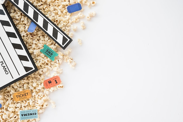 Cinema concept with clapperboard and popcorn